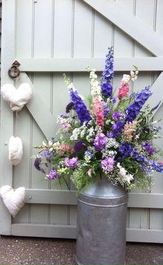 Summer Wedding flower arrangement in milk churn in pink, purple, Lilac and white by www.amyodwyerflorist.com
