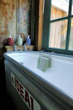 This bathtub cost $90: $50 for the cattle trough and $40 to have a fiberglass lining installed. - This is amazing.--- how huge would this tub be!? Love!