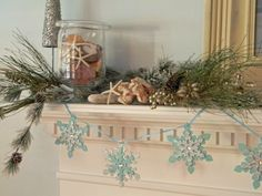Beach house Christmas mantel. I will be trying this next year!