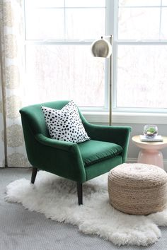 Lovely little reading nook for the master bedroom. Green velvet chair, dalmatian pillow, pink and gold martini table, and a jute poof all on a sheepskin rug.