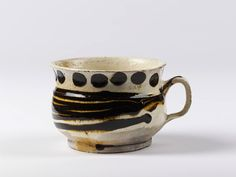 english cup ..lead glazed earhenware.....1700. Victoria and Albert Museum.