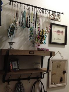Shower hooks on a towel bar? This would be really cute in Sierra's room! Jewelry organizer