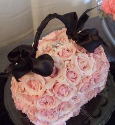 """A floral """"purse"""" of pink """"Majolika"""" Spray roses -- finished with a crystal cluster clasp and black ribboned handle - design by Heather Murdock of The Blue Orchid"""