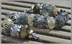 Elfbeads and rutile quartz By Deborah Taylor