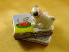 Pug on books - Porcelain Limoges from France