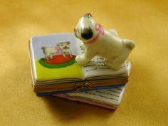 Pug on books - Porcelain Limoges from France - Limoges Factory Co.