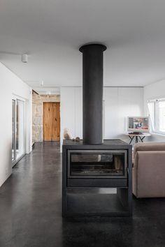 JA House / Filipi Pina + Maria Ines Costa dark concrete floors, white and natural materials