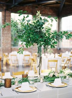 26 Refreshing Spring Wedding Centerpieces: a natural greenery wedding centerpiece in a tall vase and a matching greenery runner Spring Wedding Centerpieces, Green Centerpieces, Greenery Centerpiece, Wedding Decorations, Centerpiece Ideas, Tall Vases Wedding, Tree Branch Centerpieces, Centrepieces, Floral Wedding