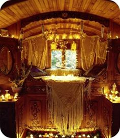 gypsy nook bed // rolling home bed // piano shawls // fringe // lace curtains // warm glow lighting