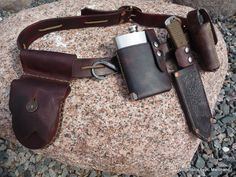 Seems like this would add a nice little 'something' to one's camping trip. And if survival became an issue, the gear it provides would be a big help, while the flask's contents might make things just a little less grim.