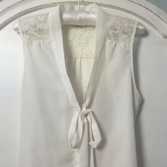 Topshop cream pussybow sleeveless blouse with pretty lace inserts. UK size 8, worn twice. UK delivery available, message me for international postage options. - Depop