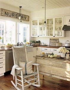 like the rocking chair and old furniture piece in kitchen area.  I also like the window like doors on cabinets.