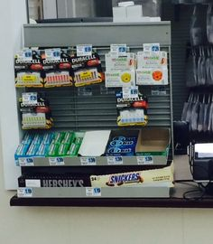 We're disappointed to see candy bars at Rite Aid's pharmacy checkout counter. (Rite Aid, Washington, DC, 8/15)