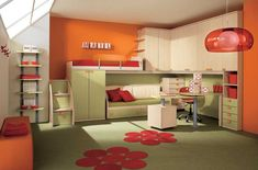 Cheerful Kid Bedroom Design With Orange Wall Paint Color And Wall Mounted Cabinets And Bunk Bed And Red Pendant Light And Sloped Wall Featuring Skylight By Arredissima