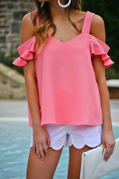 The Nina cold shoulder top in pink has a perfect sweetheart neckline and a ruffle flutter sleeve trend! Preppy and flirty style that will have everyone wanting to know where you got this top! $32.00