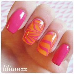 """""""Watermarble nails..❤ . Check out my instagram @liliumzz  For this mani i used #SallyHansen xtreme wear number 105 called """"Sun Kissed"""" for the orange and the pink is  #SinfulColors number 920 called """"24/7""""   #nail #nails #nailart #naildesign #nailpolish #nailstagram #manicure #mani #neglelakk #nailspiration #manikyr #nagellack  #notd #nailsoftheday #liliumzz #cutenails #cutemani #nails2inspire #watermarblenails #watermarble #pinkpolish #pinknails"""