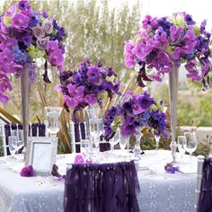 Purple wedding ideas. Centerpiece and table ideas from http://aileentran.com/blog/wp-content/uploads/2010/12/purple-fuchsia-centerpiece-santaluz-wedding.jpg