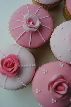 Pink rose birthday cupcakes, via Flickr.