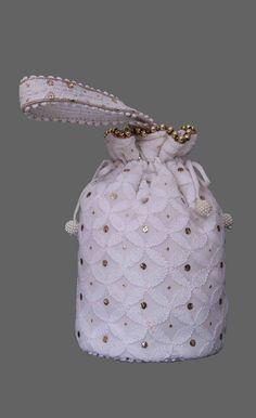 Ada #handembroidered White #Chanderi Lucknow #ChikankariPotli A561313 mixes the luxuriousness of chanderi fabric with mesmerizing excellence of #Lucknowichikan weaving  #Adachikan #Chikankari #Lakhnavi #chikanembroidery