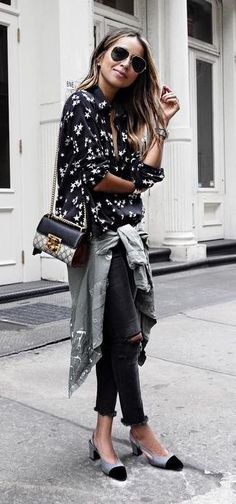 street style. black + white + grey. printed blouse. ripped jeans.