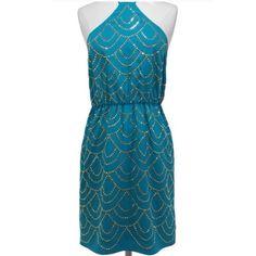 "Trina Turk Turquoise Halter Dress Gorgeous Trina Turk silk, gold studded halter dress in turquoise. Offers are welcome.❤️  Approx. measurements: Bust 30"" elasticized on back, Waist 26"" elasticized, Hem 38"", Length 33"". Trina Turk Dresses"