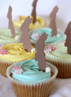 Pastel bunny cupcakes. Could do tea cups or teapots for T's birthday instead of bunnies.