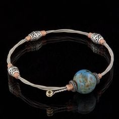 Six String Aquemini Bracelet