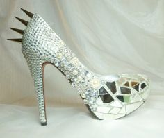 Cinderella's Revenge...Swarovski crystals, broken shards of glass and spikes.