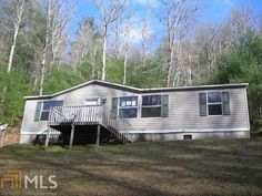 $47,000  1280 Bud Walt Rd, Blairsville: end of road privacy 3/2 doublewide w/ seasonal mountain views.  Open floor plan with a spacious feel for family and friends to appreciate. It also has the advantage of having a split bedroom plan to provide for quiet times. Outside, there is a concrete slab in place as an option for building a workshop, small garage or utility building for extra storage! Call Sue 706-809-2522. MLS 8301550