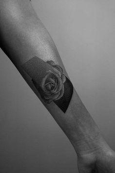 Rose tattoo on the left inner forearm.