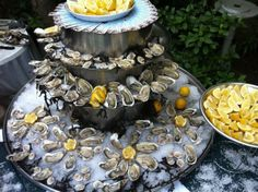 A grand way to serve oysters - and of course, with lots of lemon! I ate 3 dozen belons one night in Paris - it sort of looked like this