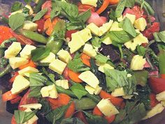 This is the yummy salad I'm taking to a 4th celebration: kale, peas, carrots, green beans, turnips, beets, oranges, golden raisins, dried cranberries, goji berries, with a dijon and toasted sesame dressing topped with raw cheese and basil. yum!