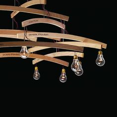 In 2009 Ingo Maurer designed an upcycle design mobile lamp called 'Oh Man, it's a Ray!'. A coat hanger chandelier and hommage to visual artist Man Ray.