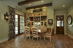 13315 Timberwild Ct Tomball, TX 77375: Photo BREAKFAST ROOM OFF THE KITCHEN WITH CUSTOM CABINETRY -- BEAD BOARD BACK, LEAD GLASS DOORS,  FRENCH DOORS. ALL WINDOWS IN HOME ARE 'WEATHERSHIELD'-- IRON OUTSIDE, WOOD ON INSIDE.