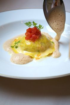 Lobster ravioli with fine herbes and shellfish bisque at Vancluse, NYC. Virtual Gourmet