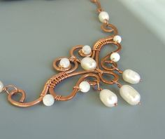 Pearl copper necklace wire wrapped statement jewelry June birthstone. $57.00, via Etsy.
