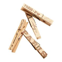 Use these cute clips to hang seating cards or to accent napkins.    Clothespins, $4 for 10, The Shabby Chic Cottage.