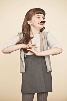 French New Comers AW 12 | MilK - Le magazine de mode enfant---- I don't really care about the clothes, I just lilke that this little girl is wearing a moustache