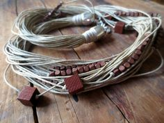 This necklace is on a sale , 30 off . The original price was $30.00. Now its only $21.00  This multi strand necklace is made with natural color waxed linen cord, small brown square wooden beads (4 x 4 mm) and large brown square wooden beads (10 x 10 mm )  This necklace could be a great accent to your outfit for a whole year.  Length of the necklace is 66.5 cm (26) with 2.5 cm (1) extension and with silver plated lobster clasp.  **Thank you for visiting my shop !**