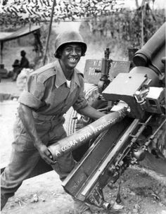 "Brazilian Army Pvt. Francisco de Paula of the Brazilian Expeditionary Force (Portuguese: Força Expedicionária Brasileira, or FEB), prepares to load a 105 mm M2A1 howitzer, shoving a shell into the breech of his gun with the inscription ""A cobra está fumando"" (""The snake is smoking"") during the Italian Campaign. The soldiers of the Brazilian Expeditionary Force called themselves Cobras Fumantes (literally, Smoking Snakes) and wore a divisional shoulder patch that showed a snake smoking a…"