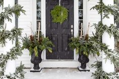 Classic winter porch with black door and porch urns Christmas Door Wreaths, Christmas Porch, Outdoor Christmas, Winter Christmas, Green Christmas, Christmas Decor, Decorating With Christmas Lights, Porch Decorating, Decorating Ideas
