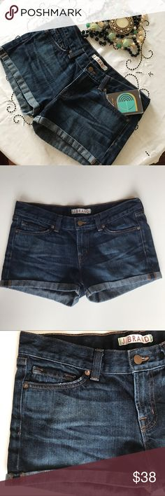 """J BRAND Eli Denim Shorts J BRAND  Eli Denim Jean Shorts  Low rise  Cuffed hem  5 pockets  Style # 1041u353 Size 27 4 100% cotton  Medium dark wash  Front whiskers  Measurements laying flat  Waist 16"""" Hip 17.5"""" Total Length 11"""" Inseam 2"""" Very Excellent preowned condition 8.7/10 button is slightly scuffed J Brand Shorts Jean Shorts"""