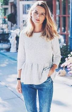 peplum sweater and blue jeans