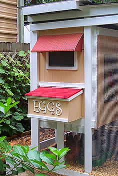 Love the awning and egg box. Look to the right and you will see a portrait of a rooster.