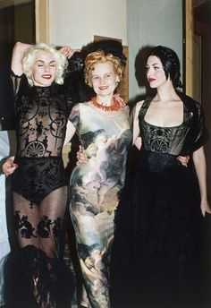 British fashion designer Vivenne Westwood poses with models wearing her creations during London Fashion Week on Oct. 14, 1991, after having won the Designer of the Year award for the second straight year.  Punk was born to be incendiary, designed to provoke . . . a rebel yell in sound and fashion. And there would have been no punk look without the lady in the orange hair.