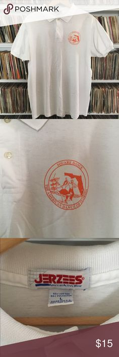 Vintage Florida square dancing polo uniform team This size large shirt was made by jerzees.  It is printed with a dancing couple proclaiming that square dance is the American dance of florida. Worn by the orange blossom Squares from the villages at lady lake. It's in fair shape. It looks ok but there is a yellowish stain on the logo that you can see in certain light. It does still look cool though. Please keep in mind that with all vintage and used clothes small imperfections may exist that…