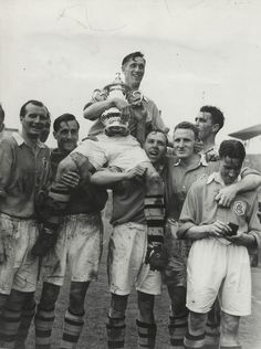 Arsenal 2 Liverpool 0 in April 1950 at Wembley. Joe Mercer is lifted high with the FA Cup by his victorious team mates.