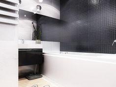 Ванная комната находится рядом со спальней. Сделана она в бело-черной гамме: белая ванна, тумба из деревянного массива со встроенной белой раковиной. Стена над ванной облицована темной стеклянной мозаикой, остальные стены – однотонной белой керамической плиткой.