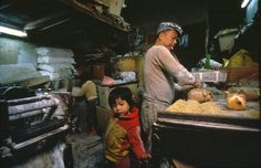 Kowloon Walled City was a former Chinese military fort turned into largely ungoverned settlement in Kowloon, Hong Kong. families used to live in 300 buildings. Kowloon Walled City was Kowloon Walled City, Hong Kong, The Babadook, World Images, Slums, Historical Pictures, The Life, Shanghai, Night Life