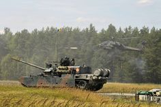Romanian tank TR-85M1 and American AH-64 Apache